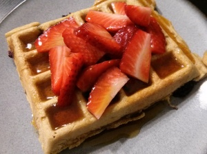Whole Wheat Blueberry Waffles topped with fresh strawberries